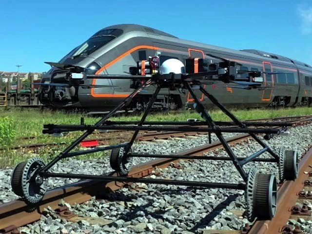 A Drone Guarding the Tracks